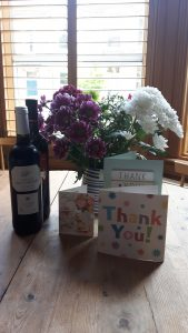 Flowers, wine and thank you cards